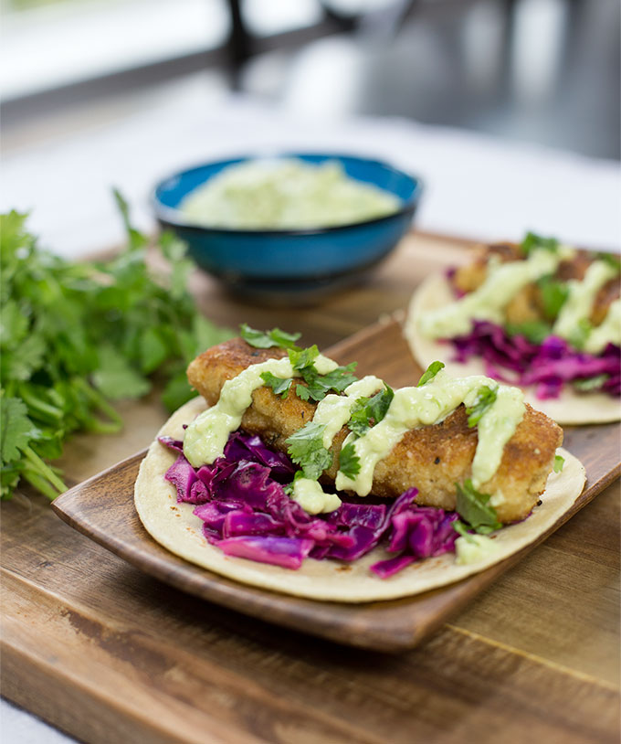 These Kodiak Cakes Fish Tacos are made with whole-grain pancake batter, fried in coconut oil and spiced up with a little Cajun kick!