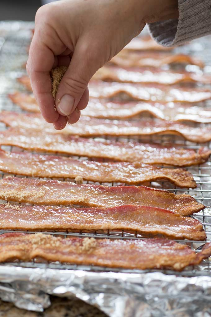 The EASIEST recipe on the planet, Caramelized Oven-Cooked Bacon is a two-ingredient wonder: bacon, brown sugar and a little heat from the oven...YUM!