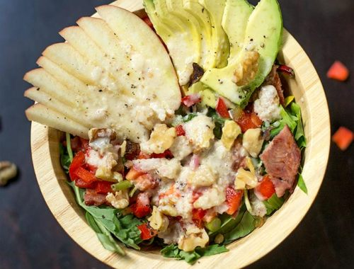 This Sweet Apple Salad combines mixed greens, avocado, red peppers and bacon then drizzled with a sweet apple vinaigrette and topped with toasted walnuts.
