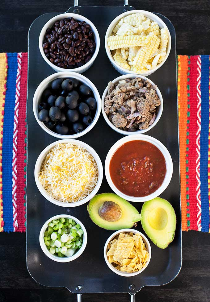 Like south-of-the-border flavors? These Mexican Tin Foil Dinners are a fire-roasted burrito bowl: beef, beans, corn, cheddar, avocado, salsa and FIRE...yum!