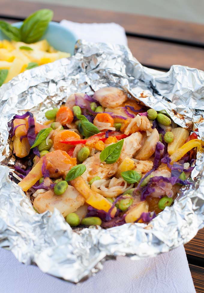Asian Tin Foil Dinners are a fun twist on the classic foil recipe! Rice noodles, veggies, chicken and peanut sauce, all cooked together over the fire.