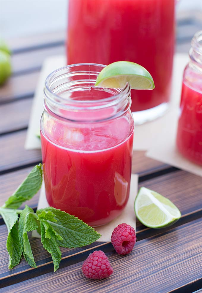 Hot summer days got you dragging? This flavor-packed homemade Raspberry-Mint Limeade will quench your thirst and pick you up on a 100-degree day!