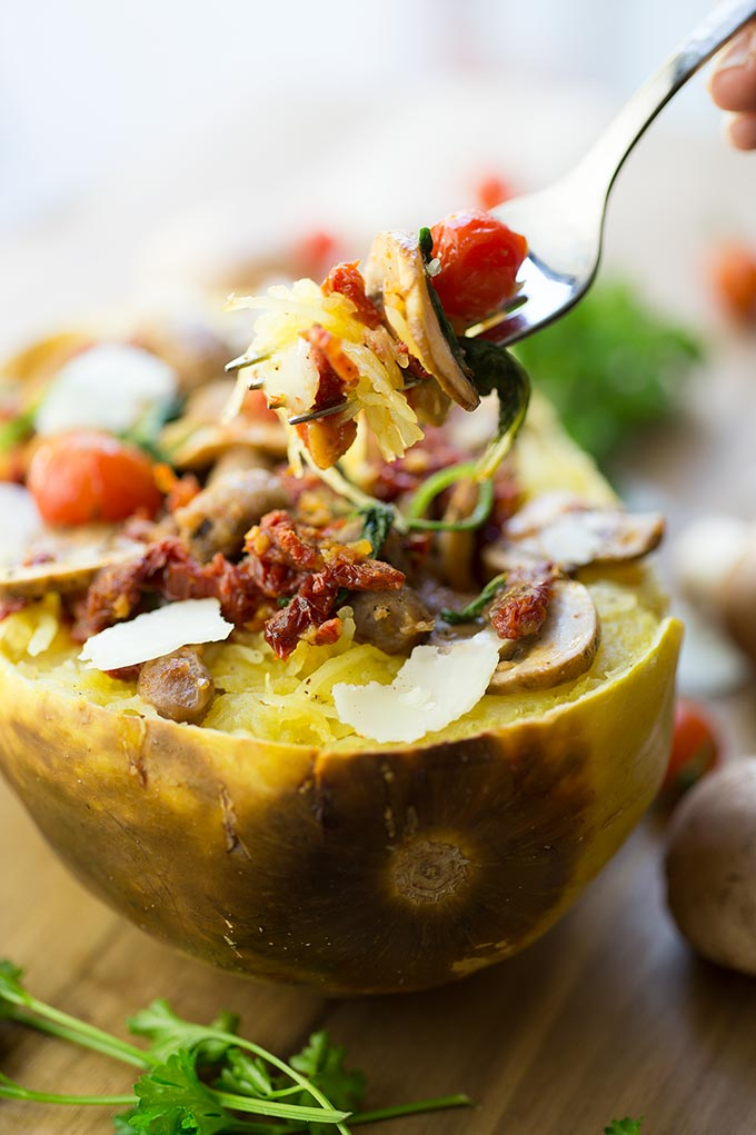 Italian Stuffed Spaghetti Squash - roasted squash loaded with vibrant veggies and sausage, sprinkled with grated cheese. A low-carb, veggie-packed dinner!