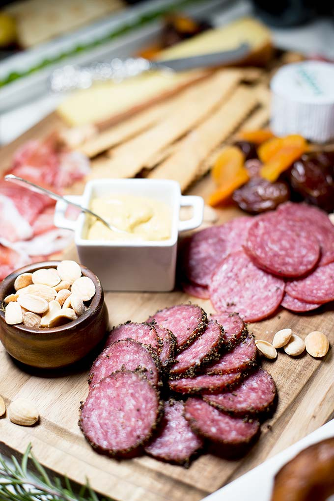 Elegant and easy, a Cheese and Charcuterie Board is simply cured meats, cheeses, raw veggies, fruits and breads all laid out on platters. Food Perfection!