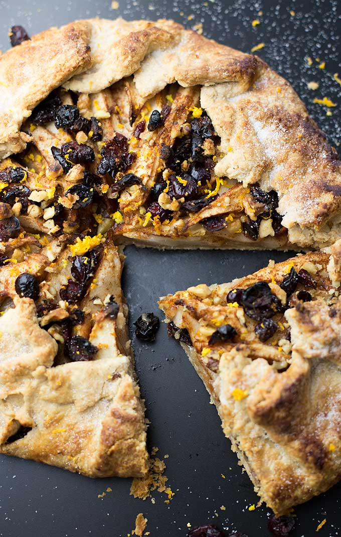 The simplest way to make pie, Pear Cranberry Galette is a free-form crust piled with fruits, nuts and spices to create a stunning, delicious dessert.