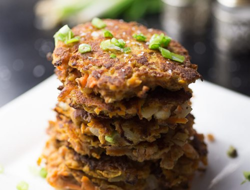 These Sweet Potato Hash Browns make the perfect breakfast! Crisp on the outside with a hint of coconut flavor, garnished with sea salt and green onion.