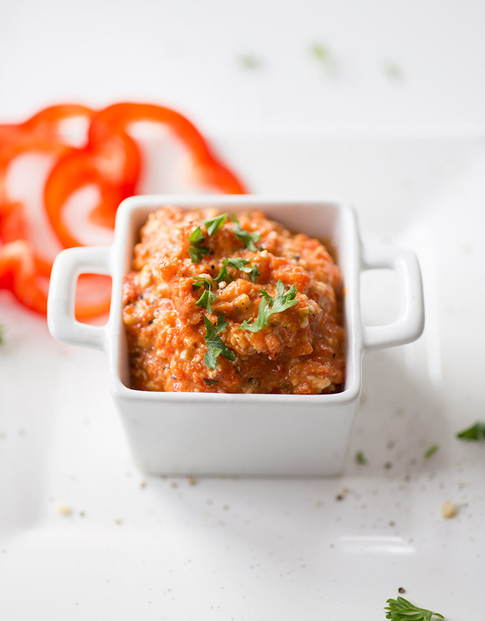 Romesco Sauce combines roasted red peppers with lemons, tomatoes, almonds and garlic to create a versatile, simple sauce, dip or marinade.