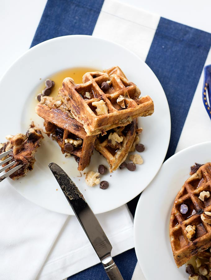Chocolate Chip Banana Walnut Waffles - the perfect waffle recipe! Bursting with chocolate chunks with an added crunch of walnuts, this one's a keeper.