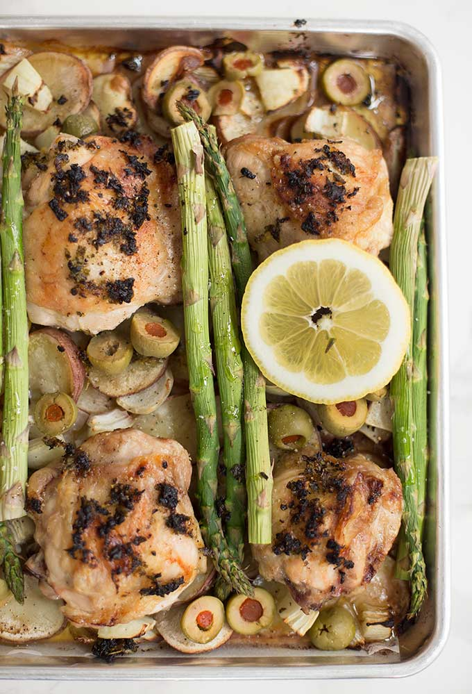 One Pan Lemon Garlic Chicken and Vegetables: Juicy chicken thighs, asparagus, potatoes, and fresh herbs roasted to perfection, with just one pan to clean!
