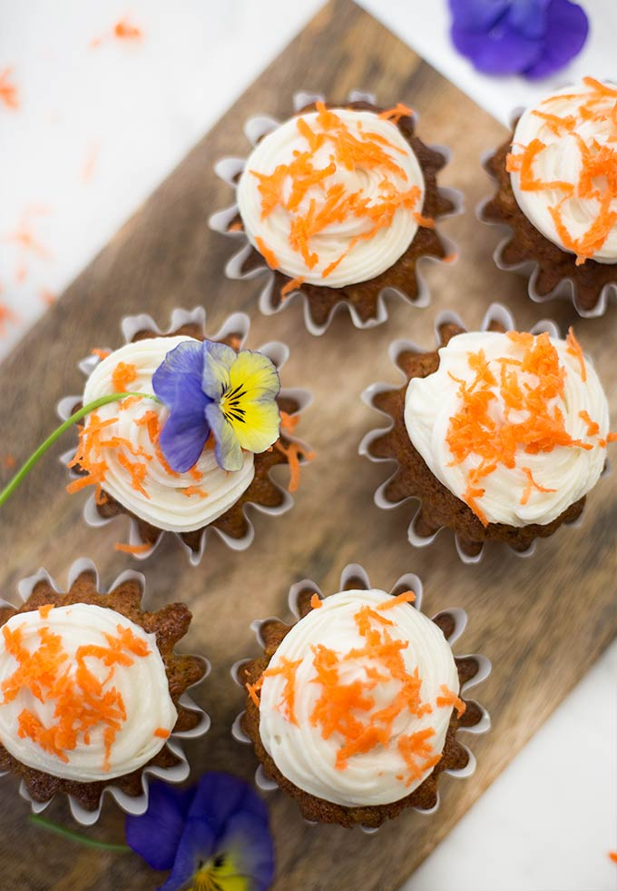 Carrot Cupcakes with Cream Cheese Frosting - soft, sweet, carrot-packed cupcakes smothered with fluffy cream cheese frosting!