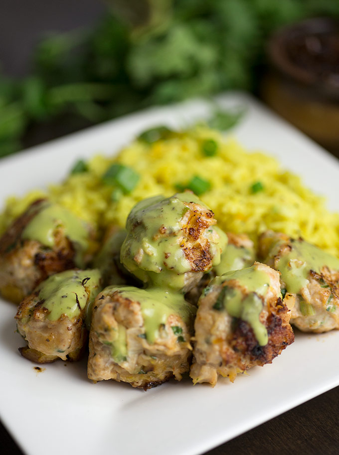 Mango Jalapeno Meatballs - a unique and delicious blend of cilantro, mango and ground chicken! Dipped in a creamy coconut sauce and fig jam.