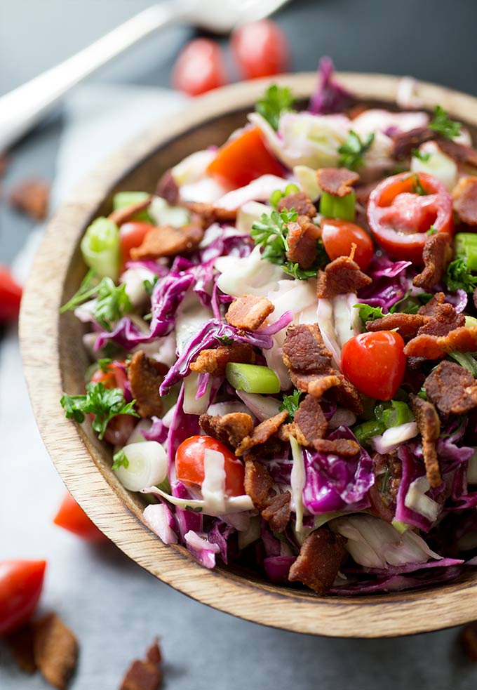 BLT Coleslaw: An elevated version of the classic coleslaw. Combines crunchy cabbage, bacon, tomatoes and homemade mayo to make the perfect bbq side!
