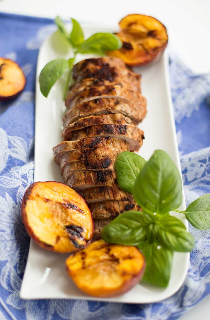 Grilled Pork with Peaches and Basil: A great way to use fresh peaches and basil, this simple marinade elevates pork with juicy, sweet flavors.