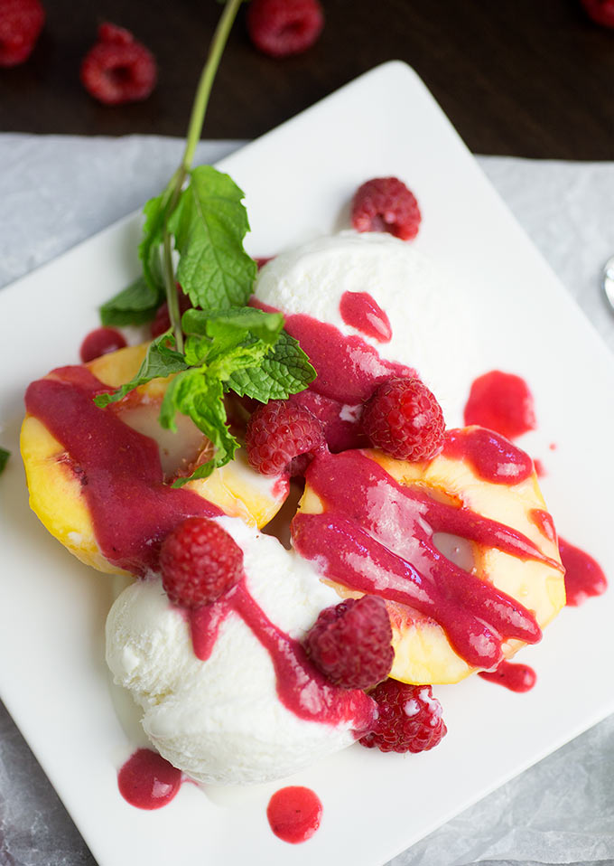 Peach Melba: Roasted peaches, vanilla ice cream and a quick and easy raspberry sauce make the perfect light, summery treat!