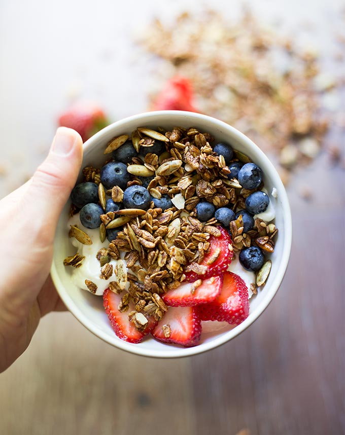 Pumpkin Flax Molasses Granola - pumpkin seeds, oats, flax and puffed rice mixed with molasses and coconut oil for a crunchy snack to top yogurt or milk.