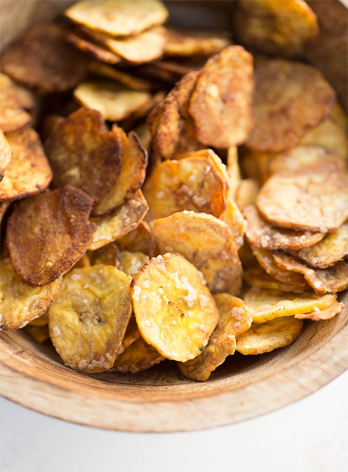 Sweet and Salty Plantain Chips - thinly sliced plantains coated with coconut oil and sprinkled with salt and/or cinnamon and coconut sugar. A crispy snack that's healthier than potato chips!
