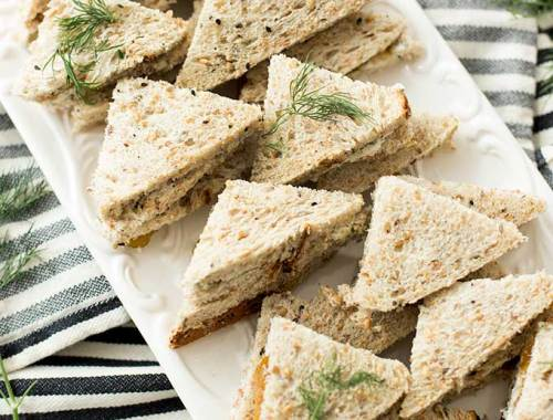 Goat Cheese and Fig Jam Sandwiches: The classic flavors of goat and fig are jazzed up with fresh herbs and pecans, and put between two slices of whole grain bread for a perfect sandwich combo.