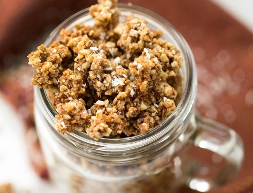 This Grain-Free Granola recipe combines nuts, seeds and coconut into crunchy granola clusters. Lightly sweetened with honey and totally grain and refined-sugar free!
