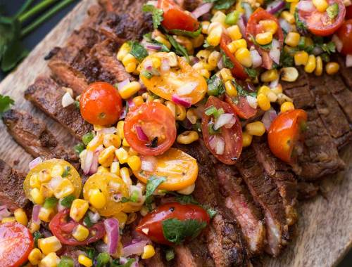 Chili Rubbed Steak with Corn Tomato Salsa - a zesty dry-rub and marinade gives this steak oodles of flavor. Top it with this roasted corn and tomato salsa and you have yourself a delicious and colorful meal!