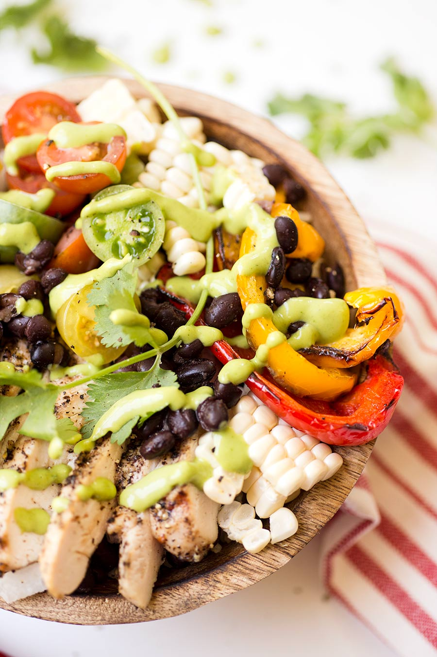 Southwestern Chicken Bowl - black beans, cherry tomatoes, fresh corn, jicama...all generously doused in a creamy lime avocado sauce.