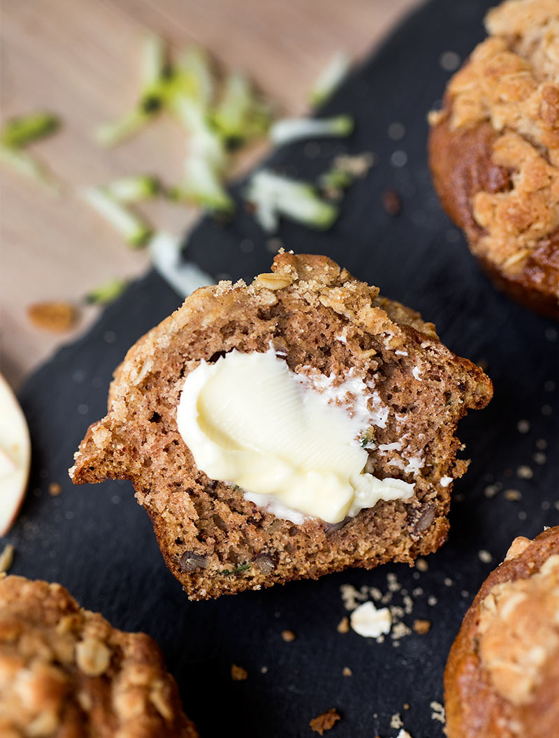 Apple Zucchini Streusel Muffins: Grated apple and zucchini baked into an oatmeal cinnamon streusel-topped whole wheat muffin.