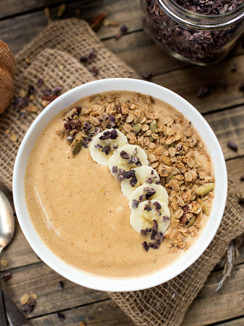 Pumpkin Pie Smoothie Bowl - a blend of frozen banana, pumpkin puree, almond butter and pumpkin pie spice for a creamy treat that you can eat with a spoon!