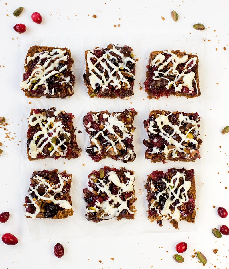 Cranberry Ginger Snap Bars: A ginger snap crust, cranberry sauce, dried fruit, nuts and chocolate chips create a tasty, quick and easy bar!