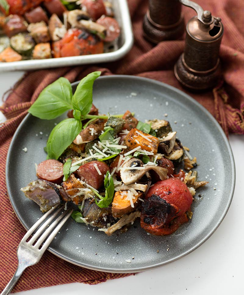 One Pan Pesto, Sausage and Veggies: Simple veggies and sausage tossed in pesto and roasted for thirty minutes to create a delicious, super-quick meal!