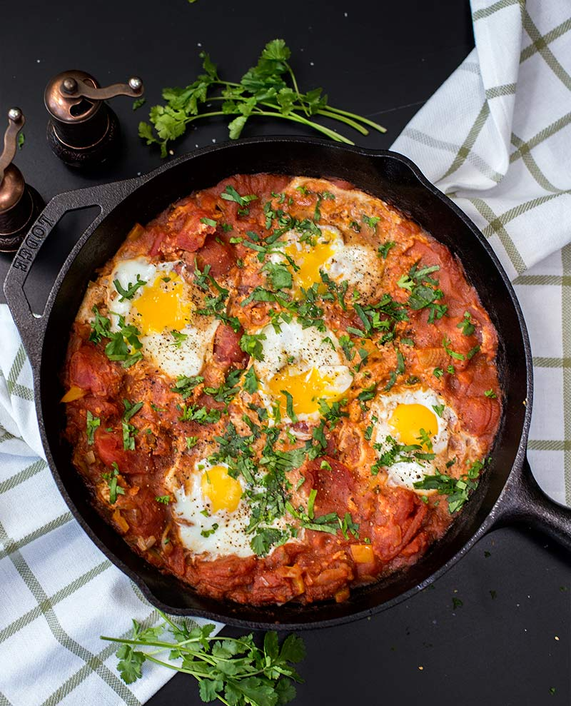 Twenty Minute Skillet Shakshuka: Eggs poached in a tomato and pepper stew create an amazing blend of North African flavors in just twenty minutes.