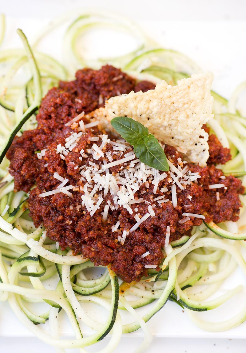 Freezer Sun-dried Tomato Pesto - sun-dried tomatoes mixed with fresh basil, garlic and parmesan cheese. Freeze into ice cube trays to always have on hand!