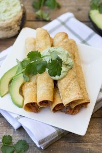 Freezer BBQ Chicken Taquitos: Kid-friendly, make-ahead-and-freeze shredded bbq chicken and cheddar tortillas drizzled with a creamy avocado dip.