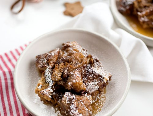 Gingerbread Bread Pudding - toasted pieces of bread baked into a ginger-spiced pudding and drizzled with a sweet vanilla sauce.