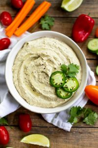 Spicy Jalapeno Cilantro Hummus - a blend of chickpeas, thahini, cilantro and lime for a smooth and creamy Mediterranean dip!