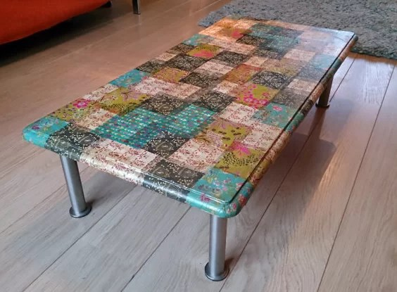 coffee table covered with scrapbook paper