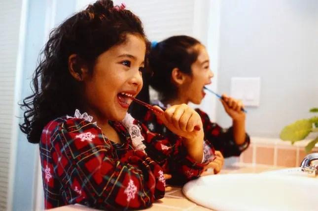 Sisters Brushing Teeth