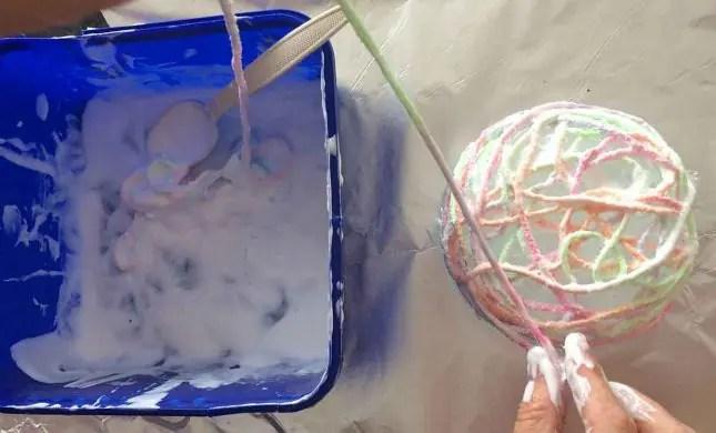 easter string basket and pompom chicken gluing