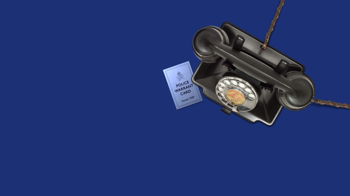 1930's bakelite telephone with Police warrant card on blue background image.