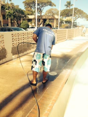 Ken power washing the pool deck