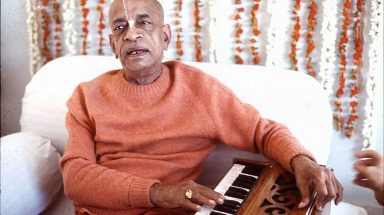 Srila-Prabhupada-playing-harmonium-and-chanting