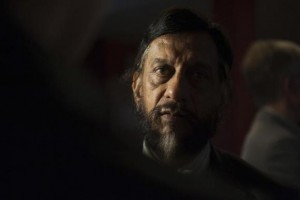 IPCC Working Group III Chairman Rajendra Pachauri talks to the media after a news conference to present Working Group III's summary for policymakers at the IPCC in Berlin