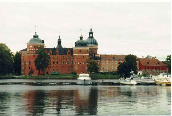 Photo of Gripsholm Castle, a brick medieval fortress on the shores of Lake Mälaren.