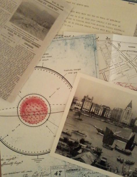 Props: Photo of boats, plan for a nuclear weapon, and some documents