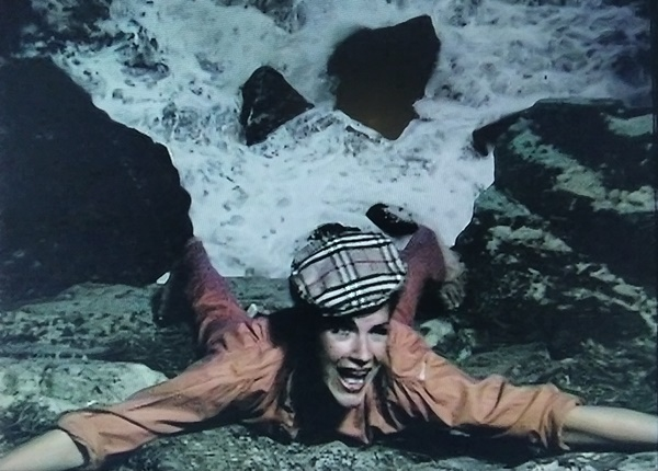 Romana hanging on the edge of a cliff