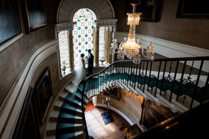 couple on the grand staircase at ripley castle