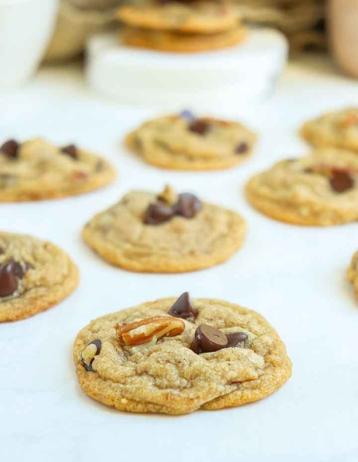 a cookie with chocolate chips and pecans on top