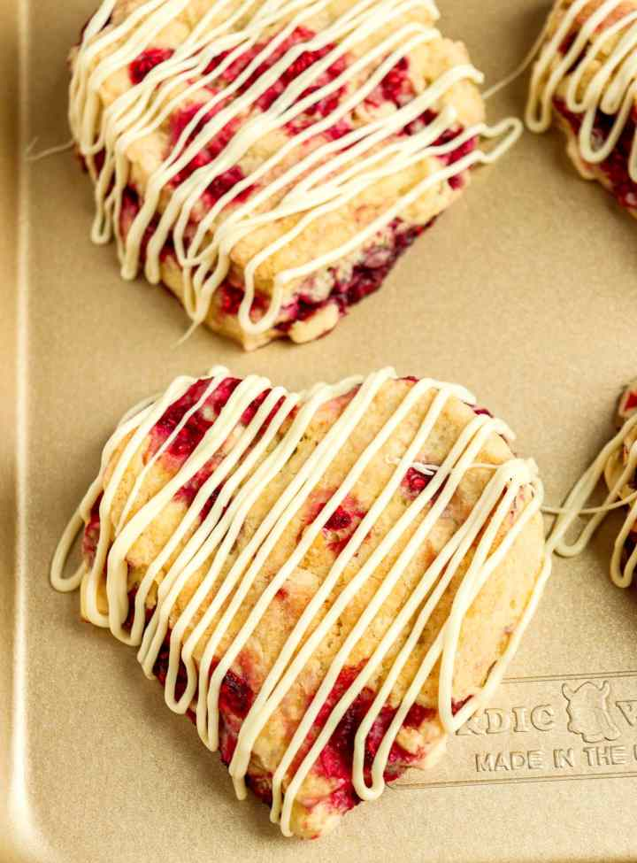 heart-shaped scones on a gold baking sheet