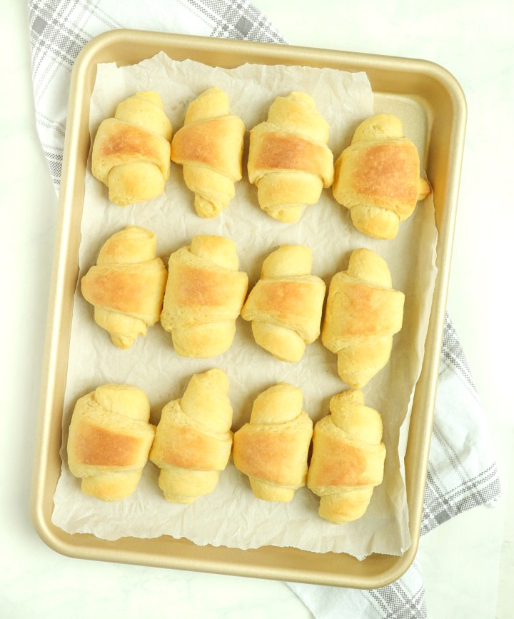 bread rolls on a baking pan