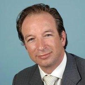 Topman Wiebe Cnossen die door de leiding van KPMG uit de wind wordt gehouden.
