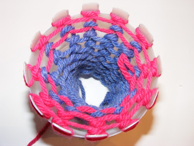 Knitting loom made from a plastic bottle