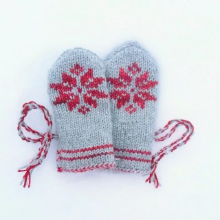 Knitted snowflake mittens for babies
